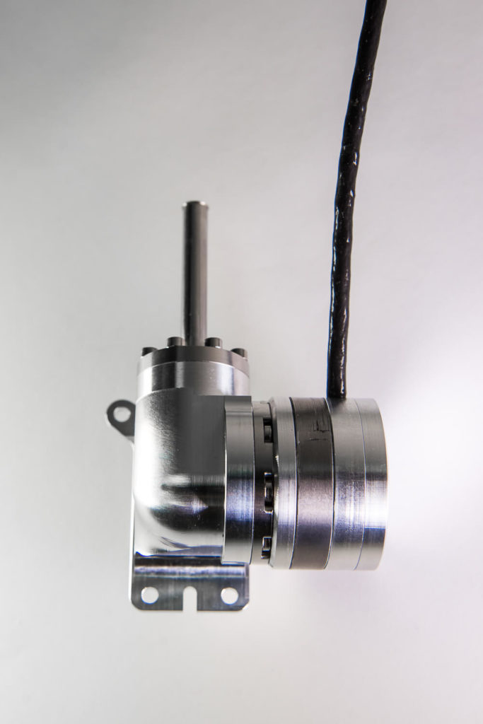 Integral stirling cryogenic cooler rotary drive with sensor
